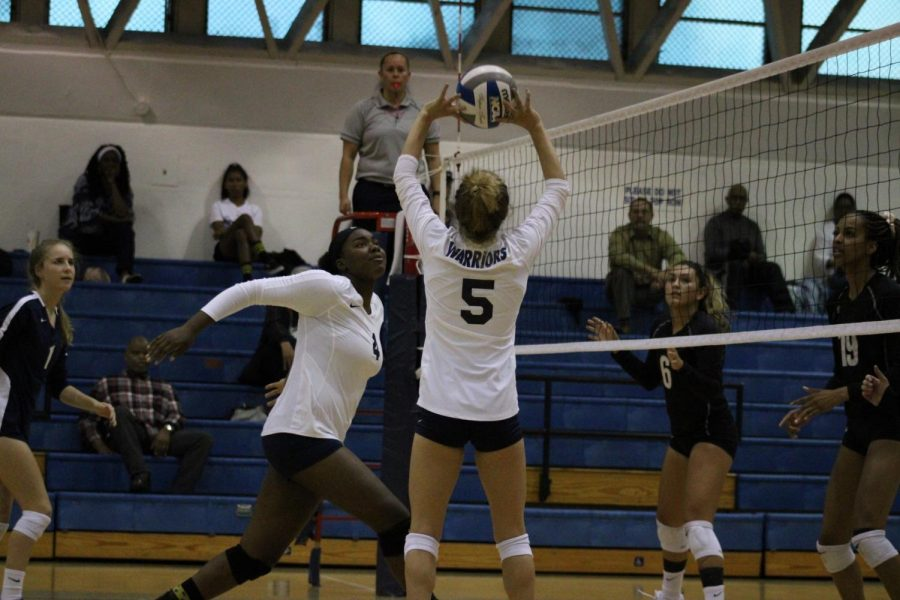 El Camino College Warriors setter Caitlin Donatucci sets the ball for middle blocker Ginia Goods during the first set of their match against Mt. San Antonio College on Wednesday, Oct. 2, at home. The Warriors are still undefeated in conference play this year, following wins against Pasadena City and East Los Angeles College.  Jaime Solis/The Union