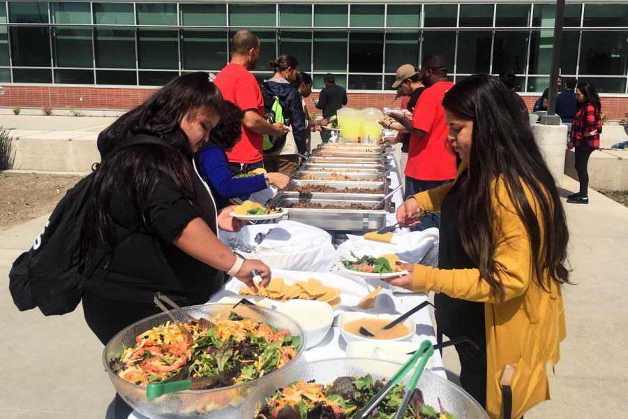 Students serve themselves hispanic foods at the Hispanic Heritage Month Kickoff Festival on Tuesday, Oct. 1. Hispanic Heritage Month is celebrated annually from Sept. 15 to Oct. 15. Juan Miranda/The Union