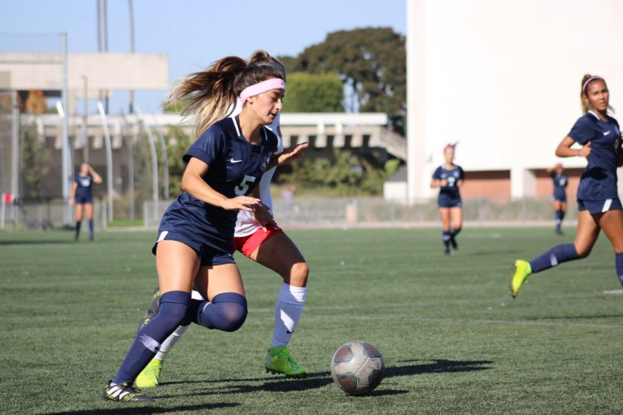 El Camino College forward Melisia Medina keeps possession of the ball during their game against College of the Desert on Oct. 15. Medina has three goals for the Warriors this season. Jaime Solis/The Union