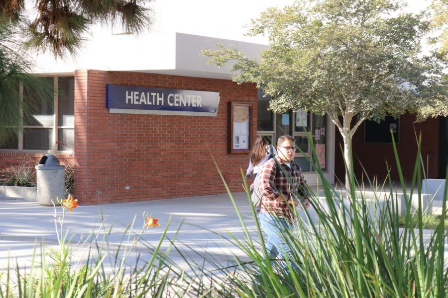 Students walk through campus and pass by the Health Center on Monday, Oct. 7. The student health fee recently increased during the fall 2019 semester to $21. Omar Rashad/The Union