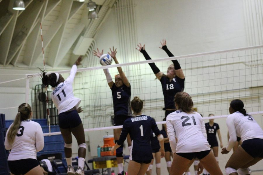 El Camino College womens volleyball team outside hitter Mikayla Clark spikes the ball against Cerritos College outside hitters Jackie Dixon and Brooke Winquist Wednesday, Oct. 23, at the ECC South Gym. Clark finished the match with18 kills. Jaime Solis/The Union
