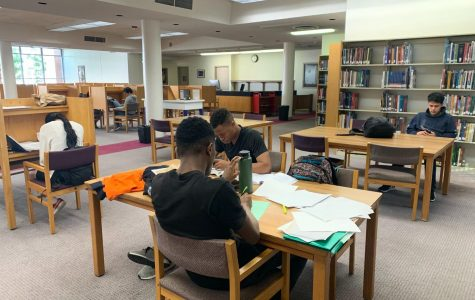 Students complete assignments in the Schauerman Library's East Reading Room on Tuesday, Oct. 8. If students are inside a classroom during an earthquake, they are recommended to take cover underneath a sturdy desk or table. Fernando Haro/The Union