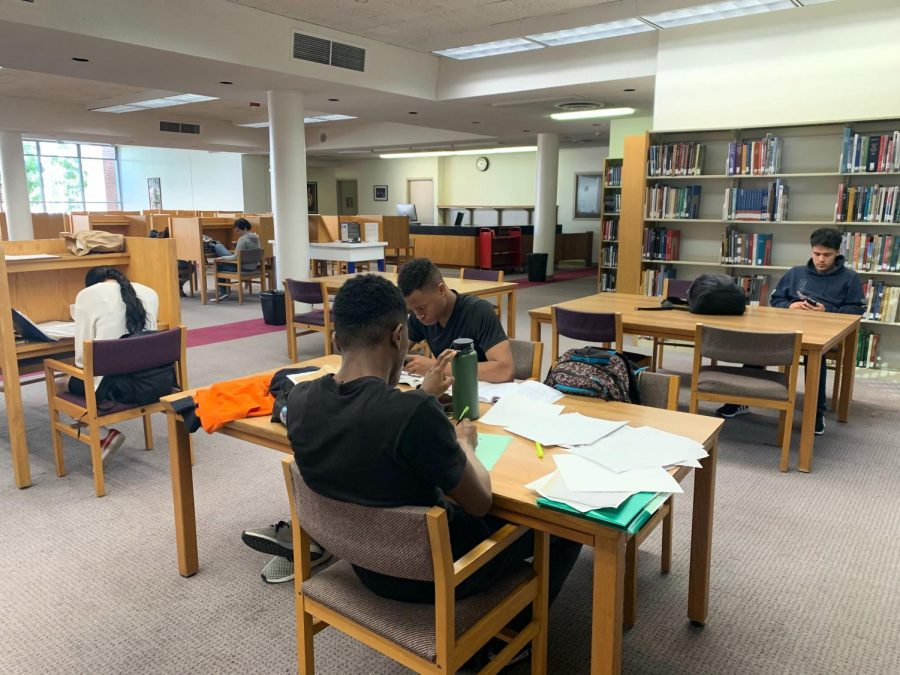 Students complete assignments in the Schauerman Librarys East Reading Room on Tuesday, Oct. 8. If students are inside a classroom during an earthquake, they are recommended to take cover underneath a sturdy desk or table. Fernando Haro/The Union
