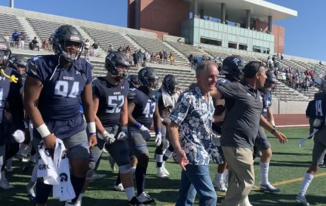 The El Camino College football team being led out by former head coach John Featherstone and current head coach Gifford Lindheim ahead of the regular season finale against Cerritos College at Murdock Stadium. Jose Tobar/The Union