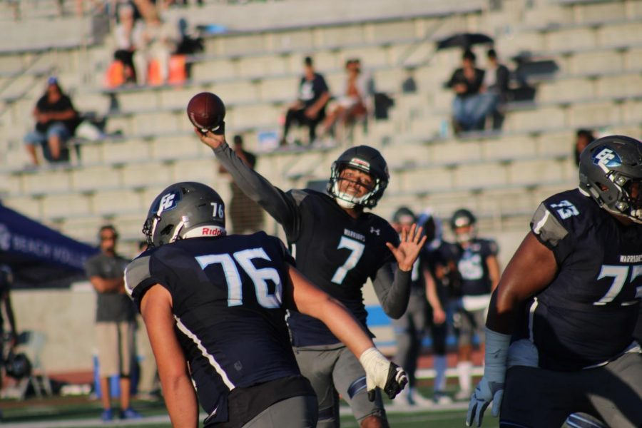 El Camino College football quarterback Jerman Gatoy attempts to deliver a pass to a wide receiver in the fourth quarter of the game against Cerritos College on Saturday, Nov. 16 at Murdock Stadium. Gotoy finished the game with 359 passing yards and three touchdowns while running for 20 yards and a touchdown. Jaime Solis/The Union