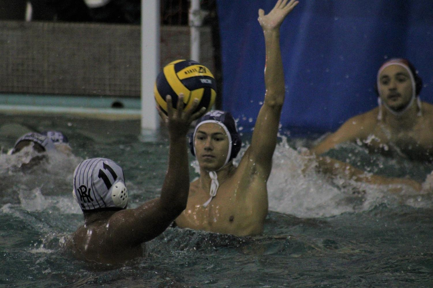 El Camino College men's water polo attacker Adian Morvice attempts to block Rio Hondo College attacker Jacob Ayala in front of the goal post during their game on Wednesday, Oct. 28 at the ECC pool. The Warriors clinched their first playoff berth since 1993. Jaime Solis/ The Union