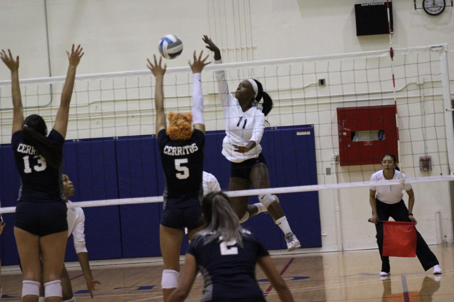 El Camino College women's volleyball team outside hitter Mikayla Clark spikes the ball against Cerritos College outside hitters Jackie Dixon and Alexia Torres Wednesday, Oct. 23, at the ECC South Gym. Clark finished the match with18 kills. Jaime Solis/The Union