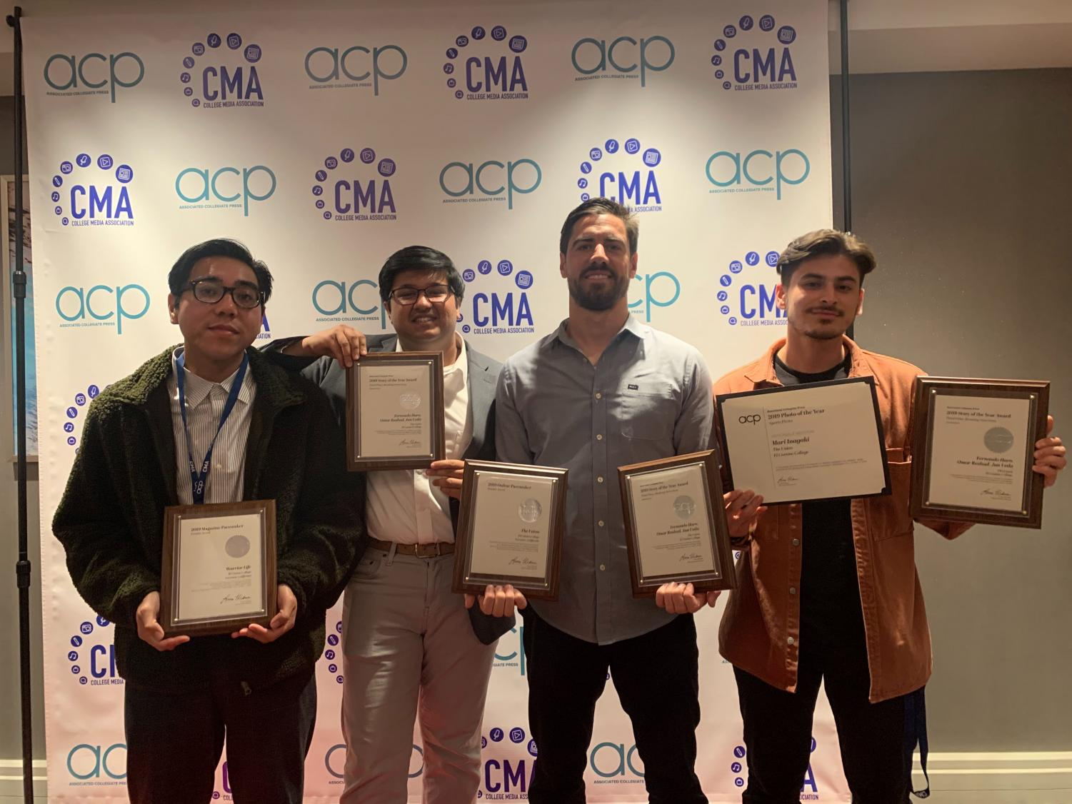 From left, Warrior Life Editor-in-Chief Kevin Caparaso and The Union's Managing Editor and News Editor Omar Rashad, Copy Editor Ryan Farrell and Editor-in-Chief Fernando Haro receive awards at the National College Media Convention on Saturday, Nov. 2. The Union newspaper and Warrior Life magazine received national awards from the Assoicated Colegiate Press and College Media Association. Photo courtesy of Stefanie Frith, Student Media Advisor