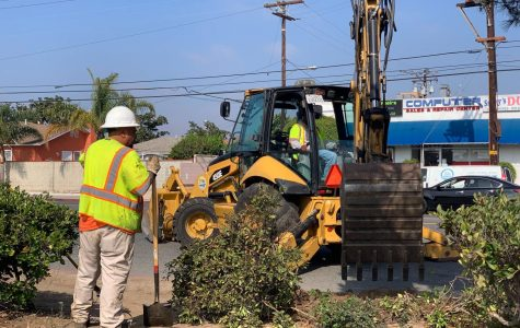 Construction workers use an excavator to dig into part of the sidewalk on Manhattan Beach Boulevard on Wednesday, Nov. 6 as part of a plan to fix the area. The street will have a parking closure until Monday, Nov. 18 and extends from the south side of Manhattan Beach Boulevard between the Dominguez Channel and Crenshaw Boulevard. Fernando Haro/The Union