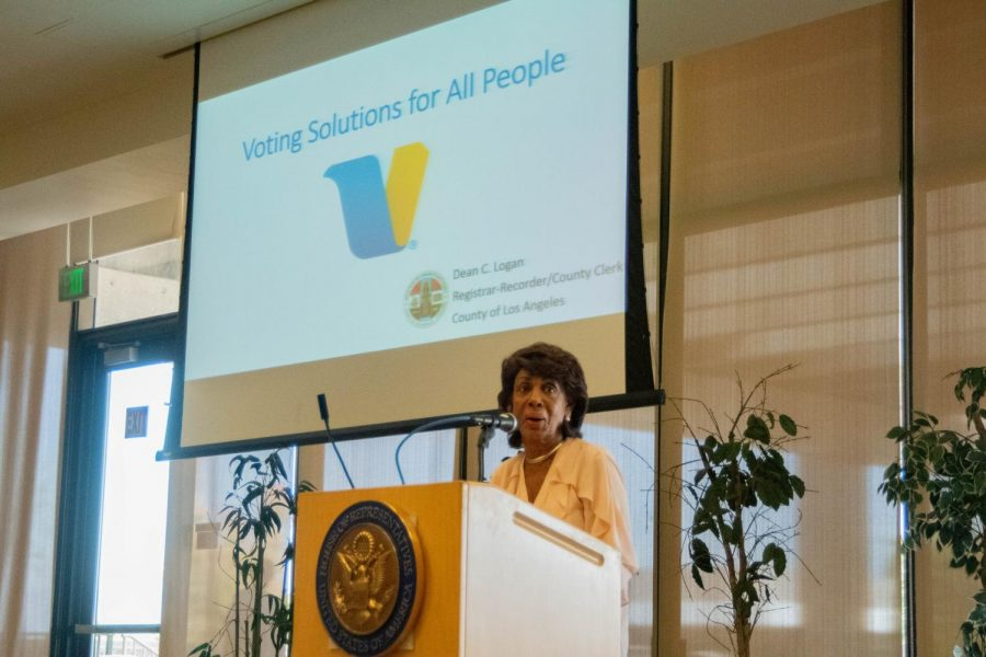 Rep.+Maxine+Waters+greets+attendees+of+the+Los+Angeles+County+Voting+meeting+before+introducing+Los+Angeles+County+Registrar-Recorder%2FCounty+Clerk+Dean+C.+Logan+to+present+the+new+way+people+will+vote+in+the+upcoming+election.+Rosemary+Montalvo%2FThe+Union+