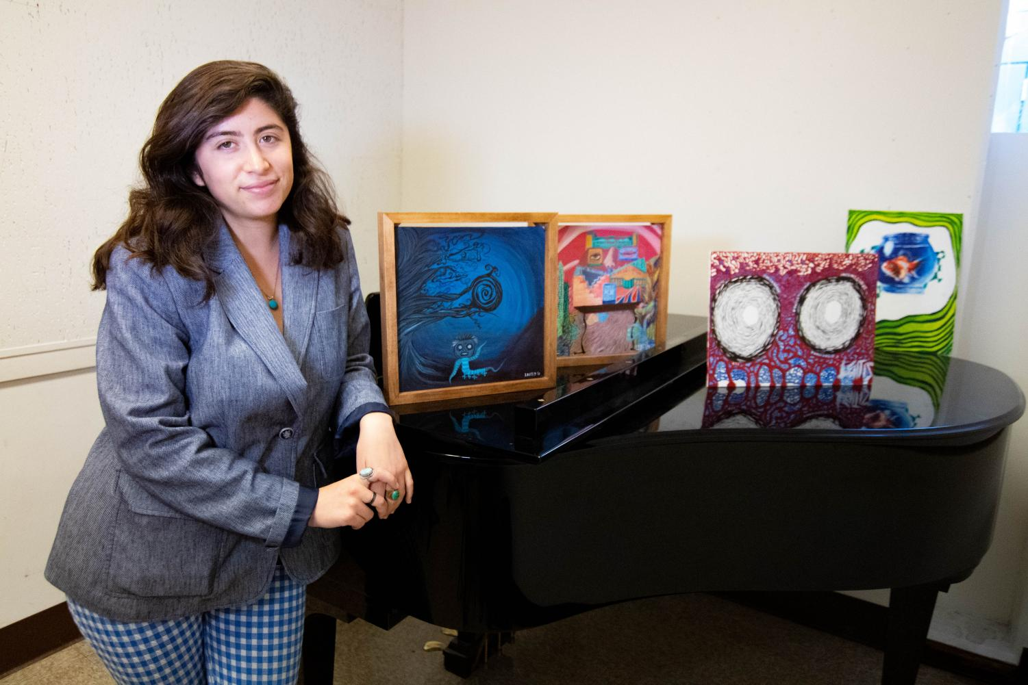 "Leilani Padilla, 22,  is an artist, musician, poet and aspiring microbiologist. Art pieces left to right: ""In the Shadows"", ""The House with the Face"", ""What Anxiety Feels Like"" and ""phiSHbrol"".  ""My dream is to change the world and to do that with the gifts that I was given."" Padilla said. Rosemary Montalvo /The Union"