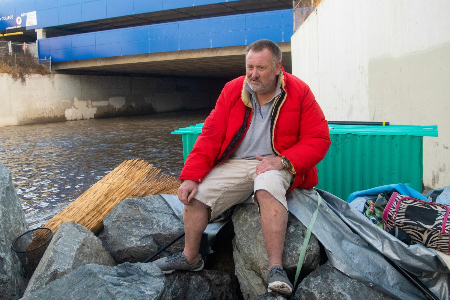 Tim Warren, 58, a Dominguez Channel resident, faces danger due to the flooding caused by a rainstorm Wednesday, Nov. 20. Homeless encampment residents face the increasing risk of accidental drowning as one encampment resident drowned in 2017 as a result of surging water levels during a storm.