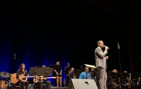 David Moyer, Director of Jazz Studies at El Camino College introduces the band and provides a brief explanation of the songs the audience will listen to during the concert in Marsee Auditorium on Wednesday, Nov. 20. Photo credit: Jose Tobar