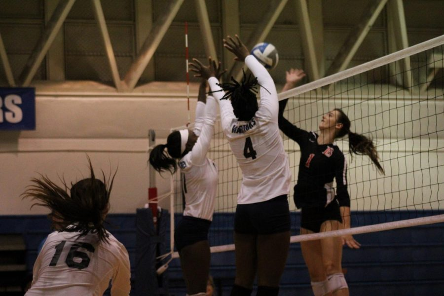 El Camino College women's volleyball middle blocker Ginia Goods, No. 4, and outside hitter Mikayla Clark, No. 11, block a spike attempt from Long Beach City College opposite hitter Alanna Shields during the match against LBCC on Friday, Nov. 8, in ECC's South Gym. The Warriors will play against LBCC for the South Coast Conference Championship on Tuesday, Nov. 19 at 7 p.m. at LBCC Hall of Champions gym. Jaime Solis/The Union