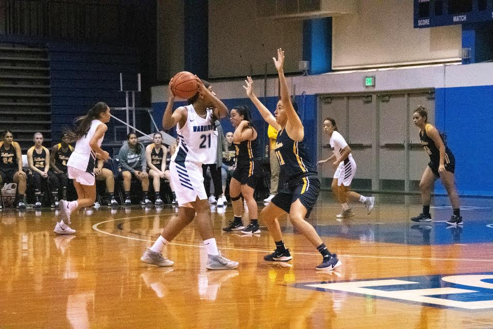 El Camino College women's basketball guard Alexia Mason looks to pass the ball to an open teammate during a match against Fullerton College on Friday, Nov. 8, in the North Gym. Mason had 12 points and 10 rebounds in the 63-47 loss. Rosemary Montalvo/The Union