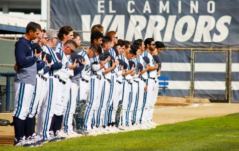 The El Camino College men's baseball team stands solemnly during the national anthem before their game against Mt. San Antonio College, Friday, March 1, at Warrior Field. The Warriors won more games than of any California Community College in 2019. Mari Inagaki/The Union