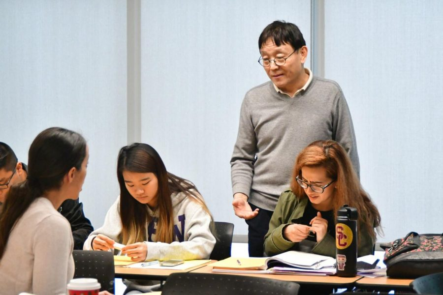 Chinese and Japanese language professor David Shan, center, helps El Camino College students, left to right, Danielle Boyer, 37, Megan Lin, 19, David and Angela Estrada, 24, with their assignment during their Chinese 2 class Tuesday, Dec. 3. Shan believes that learning a new language is one of the most valuable skills a student can develop. Rosemary Montalvo/The Union