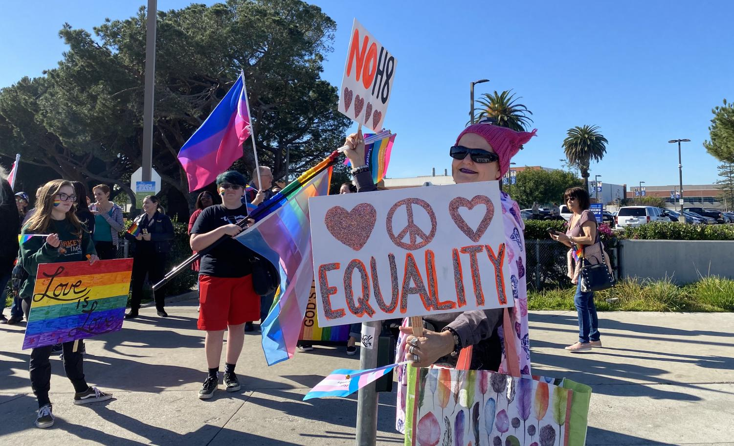 Supporters of LGBTQIA+ community hold rainbow flags and posters promoting love and equality outside El Camino College on Monday, Jan. 6. Counter-protestors overwhelmed the handful of Westboro Baptist Church and anti-gay demonstrators.