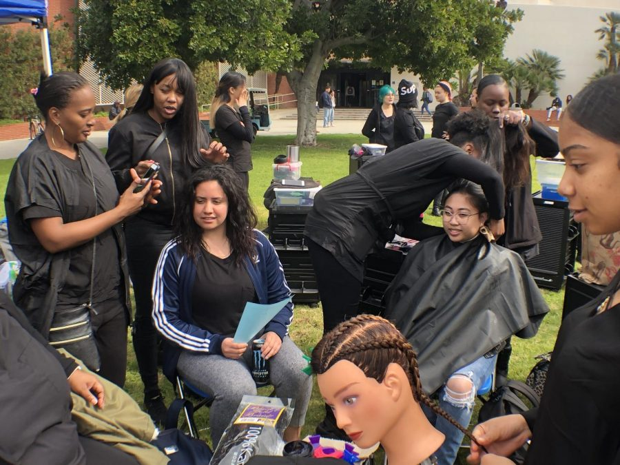 Students put on an outdoor salon at the Library Lawn during Club Rush on Wednesday, Feb. 27, 2019. More than 50 clubs will offer students food, music and prizes during this year's Club Rush starting Monday, March 2. Jaime Solis/The Union