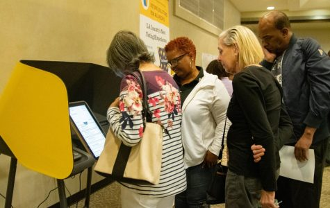 Attendees of a meeting regarding the new voting system being instated in Los Angeles County test touchscreen-operated voting machines on Saturday, Nov 2, 2019 in El Camino College's East Dining Room. The new program, Voting Systems for All People (VSAP) is expected to help expedite and make voting easier for those with busy schedules, disabilities and language barriers.  Rosemary Montalvo/The Union