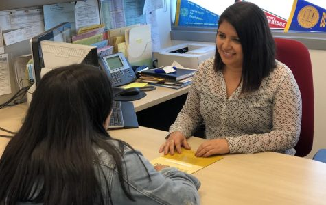 Lesley Meza, an academic counselor at El Camino College, speaks with a student. Meza celebrated her fifth anniversary as an employee of ECC in January 2019. Jorian Palos/The Union
