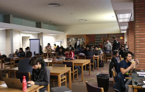 Students gather in the Schauerman Library's West Reading Room on Tuesday, March 10. The Health Center and the Schauerman Library are two student services that will remain open while in-person classes are moved online from Wednesday, March 18 until Monday, April 20. Molly Cochran/The Union