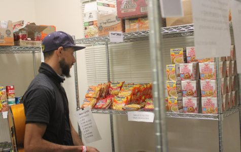 Michael Nicoli, 32, music major, browses the instant food section in El Camino College's Warrior Food Pantry on Monday, March 2. Eligible students can use newly available hot water to make foods including oatmeal and instant ramen. Kealoha Noguchi/The Union