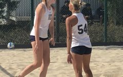 El Camino College women's beach volleyball players Brooke Drajos and Giulia Alessandri celebrating a point during their match against Cypress College on Friday, Feb. 28 at ECC sand courts. The Warriors won all 15 matches they played in the three game schedule. Logan Tahlier/The Union