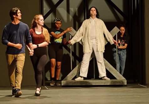 "Lead actors Daichi Marian (Capt. Walker), from left, Lindsey Stutz (Mrs. Walker) and Sammi Bronow (Tommy) rehearse for the El Camino Theatre Department's production of ""The Who's Tommy"" Tuesday night, March 3 in the Campus Theatre. Background actors are Myla Flowers and Alexa Ocampo. The musical is directed by Bill Georges, choreographed by Liz Hoefner Adamis and with musical direction by Anthony Moreno. Marian, 19, is an ECC theatre major and Stutz, 22, is a music major. Bronow, 25, is a professional actor based in Hawthorne. There will be nine performances of ""Tommy"" in the Campus Theatre beginning March 13. Photo by Duane Tada/Special to the Union"