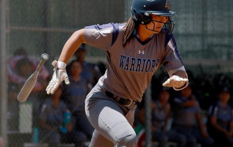 El Camino College softball player Mina Nakawake running to first base following a hit against San Diego Mesa College at ECC Softball Field on Saturday, May 4, 2019. Nakawake was one of four softball players from last year's team to be selected to the Academic All-State Team. Mari Inagaki/The Union