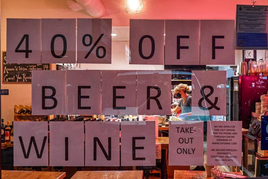A home-printed sign with specials is displayed on the window of Jame Enoteca, a restaurant in El Segundo, on Friday, May 1. As the COVID-19 lockdown took over, small businesses had to get creative with advertising in an effort to stay afloat. (Cameron Klassen / Warrior Life)