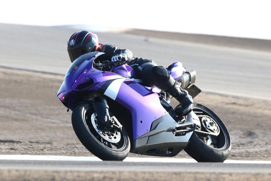 "Francesca Wilby rides her Ducati bike, which was repainted by Michele Matamoros. ""The original color code I had in mind was duller than I wanted and (Michele) found a different purple that was the absolute best I could have asked for,"" Francesca says. Photo by Cali Photography / Courtesy of Francesca Wilby"