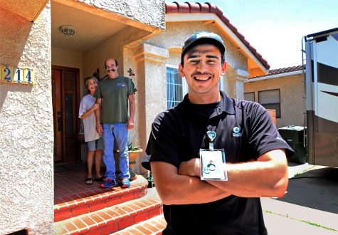 EMT Jayden Martinez, 20, keeps a safe distance from his grandparents Loudres and Nelson Martinez. Jayden has moved into his family's RV during the COVID-19 pandemic to keep his family safe from infection. Photo credit: Gary Kohatsu