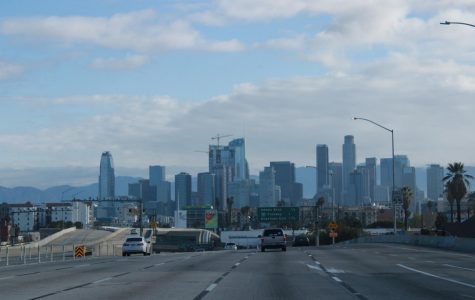 The Downtown Los Angeles skyline looms over a mostly empty Northbound I-110 freeway on Tuesday, April 7, at 9 AM. Due to statewide stay-at-home orders, freeways that are usually full of commuters making their way to work at this time have been left largely abandoned. Jaime Solis/The Union