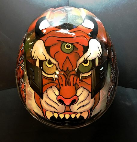 A motocycle helmet displays Michele Matamoros' brand label of a Three Eyed Tiger. The painted helmet was one of Michele's many semester projects of her Automotive Collision Repair and Painting class at El Camino College. Photo by Michele Matamoros