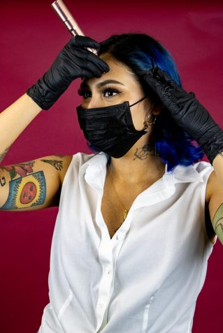 Nina Rojas poses with an instrument called the Venus, a wireless pen from Elle Marie Co. that she uses to tattoo her clients' eyebrows–a technique known as microblading. Photo credit: Rosemary Montalvo