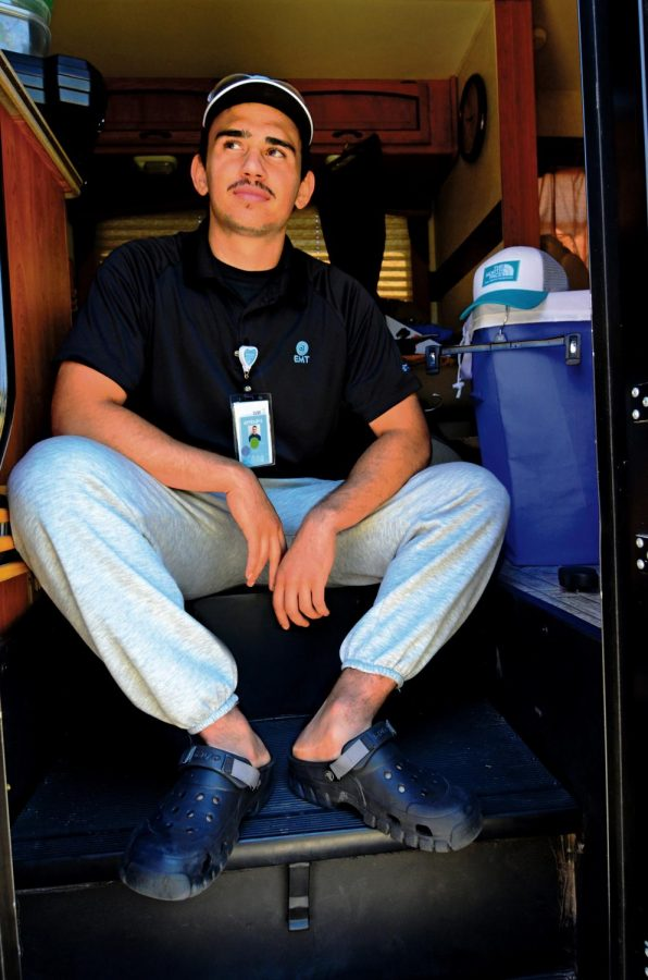 Jayden Martinez, 20, works as an EMT driver. To reduce the risks of infecting family members, he has moved into a family RV during the COVID-19 pandemic. Jayden hopes to one day work as a firefighter.