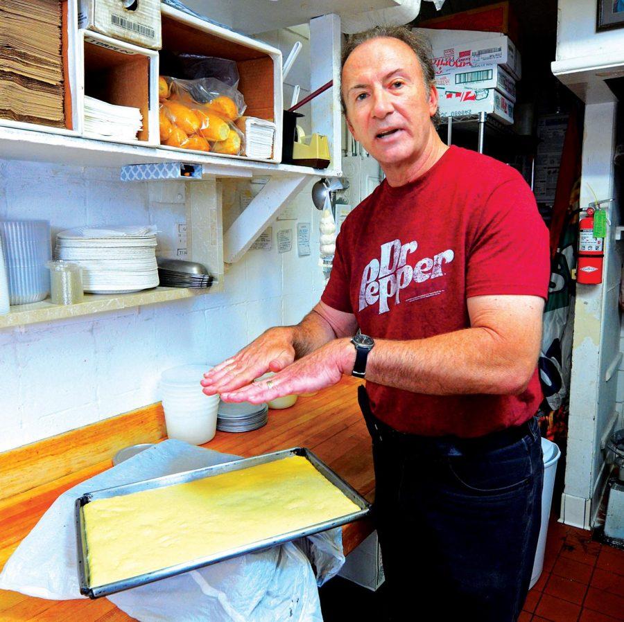 Gigi's owner, Bob Gilewski, explains the process of preparing Scilian pizza dough for some orders.