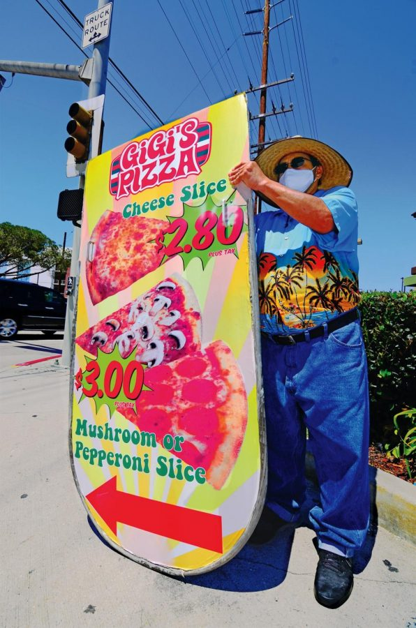 Freelance sign twirler Pablo Ramos hopes to attract passers-by at the corner of Crenshaw and Redondo Beach boulevards two days a week. Pablo, 53, of Gardena, has worked for Bob Gilewski, the owner of Gigi's Pizza and a Subway Restaurant across from El Camino College.