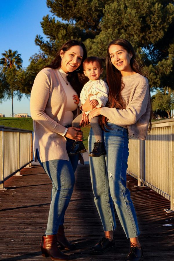 Samantha Schreider, 24, [right] with her mother, Ruth Valdez, 42, and her 1-year-old daughter, Emma Schreider, at Shoreline Park in Long Beach, California. Photo credit: Rosemary Montalvo