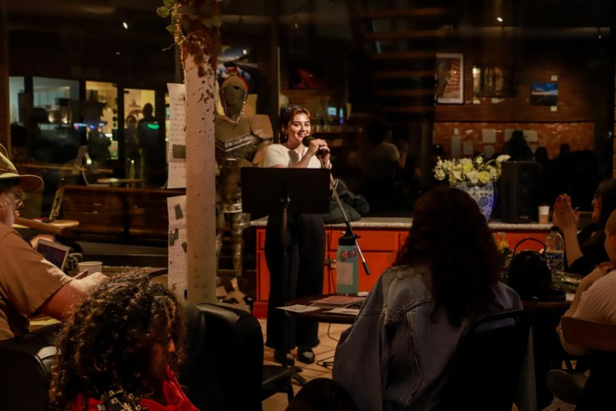 Thea Rosemary, a 21-year-old studio art major at El Camino College performs a poetry set at Coffee Cartel in Redondo Beach, on Tuesday, March 3. She read original poems covering different aspects of her life that include past relationships and being a writer.