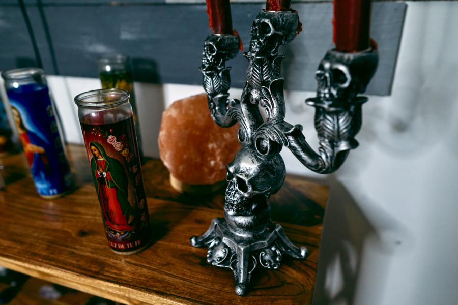 "Nina Rojas workspace, located in her parent's home in Hawthorne is decorated with candles and crystals–items that cater to her spirituality. ""I just found that it's really helpful for myself in terms of healing and like feeling better about myself,"" Nina says."