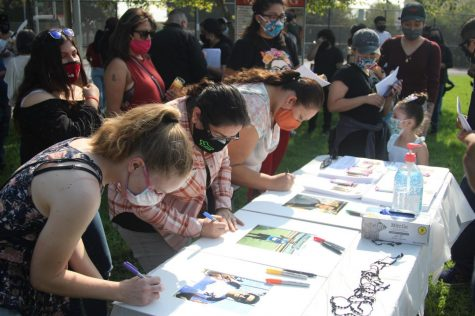 Attendees to the vigil were invited to write their thoughts and hopes to Juan Carlos Hernández on frames around pictures prepared by his family for the Vigil on Sunday, Oct. 4.
