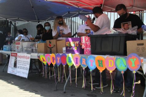 Juan Carlos Hernández, a part-time engineering student at El Camino College, has been missing since late evening Tuesday, Sept. 22. In honor of his birthday, his family decided to give back to the community on Thursday, Oct 15, setting up tents on the corner of San Pedro Street and Seventh street in downtown Los Angeles to distribute some food and toiletries to the homeless residents of nearby Skid Row. Image taken Thursday, Oct. 15. (Jaime Solis/ The Union)
