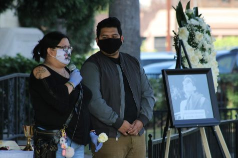 Yahaira Hernández, accompanied by her oldest son, Joseph Hernández, speaks to those in attendance of the mass in honor of Juan Carlos Hernández on Wednesday, Nov. 25, thanking them for their constant support and asks for their prayers for her family moving forward. (Jaime Solis/ The Union)