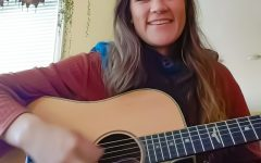 De Ana Abinante plays a few chords from her living room in Inglewood, Calif., on Dec. 2, 2020.