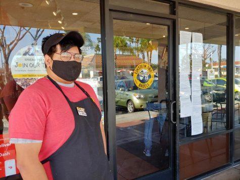 Jonathan Jaramillo, 28 year-old employee poses outside Einstein Bros. Bagels on Feb. 28 in Long Beach, CA. (Shirene McKinney/The Union)