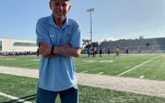 Former head football coach John Featherstone stands in front of Featherstone Field, called Murdock Stadium field at the time and soon to be renamed in his honor, during football practice Aug. 21, 2019. Throughout his entire career, he helped student athletes become not only the best players they could be, but the best person they could be. Photo Credit: Jose Tobar