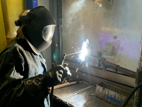 Gwendolyn Williams, 49 year-old welding major, welds together two pieces of metal in her Welding 1B class at El Camino College on March 10, 2021. Some essential lab classes, like welding, are happening at ECC despite most courses being conducted online. (Molly Cochran/The Union)