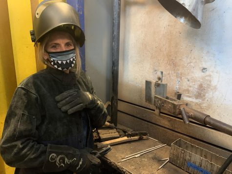 Gwendolyn Williams, 49 year-old welding major smiles with her welding equipment in the Welding 1B class on March 10. Williams wears one mask to protect herself from COVID-19 and one helmet to protect herself from welding sparks at El Camino College in Torrance. (Molly Cochran/ The Union)